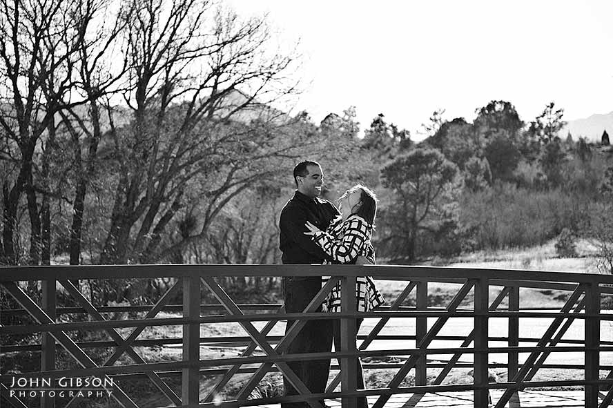 Jessica & Juan share a laugh on a bridge