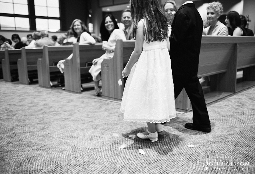 The flower girl and ring bearer walk down the aisle