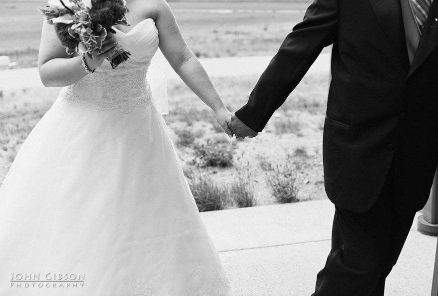Jessica + Juan hold hands