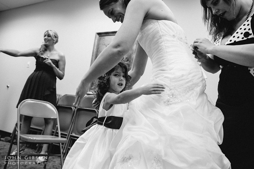 A touching moment with the flower girl and bride