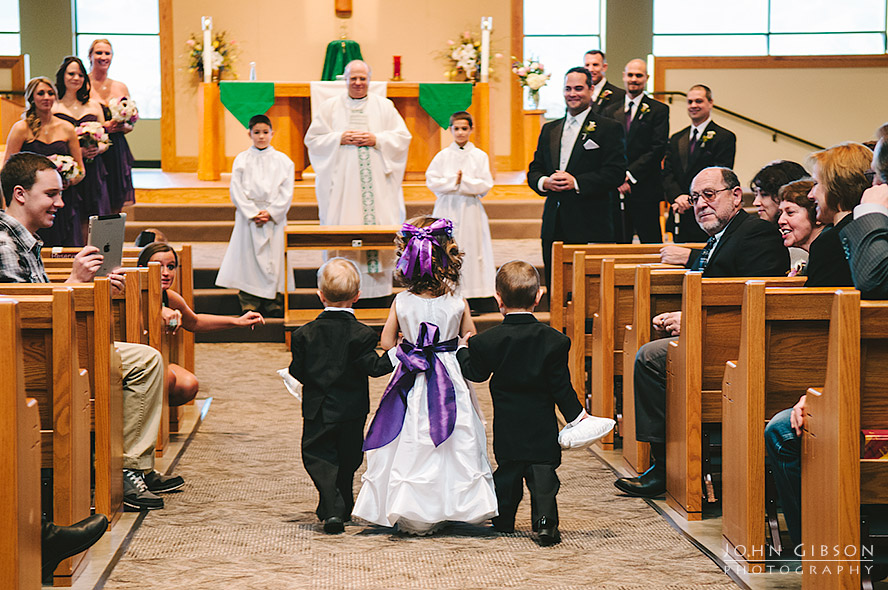 Flower girl and ring bearers walk down the aisle